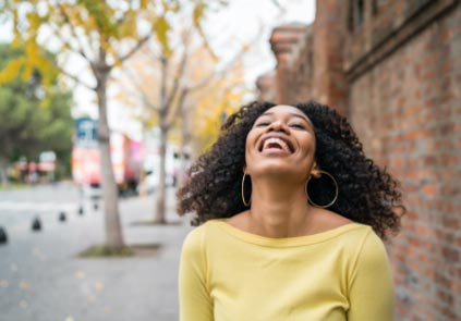 Lady laughing in street