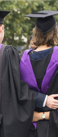 Students at graduation wearing caps and gowns